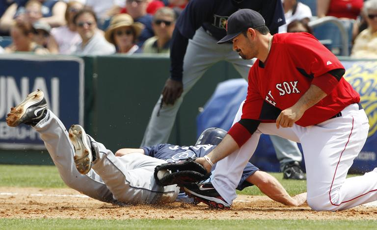Red Sox first baseman Adrian Gonzalez applies a late tag on an unsuccessful pick off attempt during a spring training game. (AP)