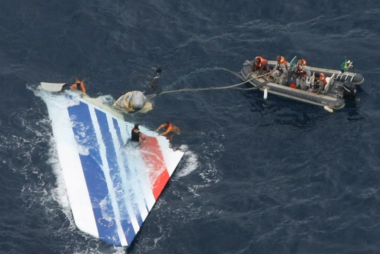 In this June 2009 file photo released by Brazil's Air Force, Brazil's Navy sailors recover debris from the missing Air France Flight 447 in the Atlantic Ocean. (AP)
