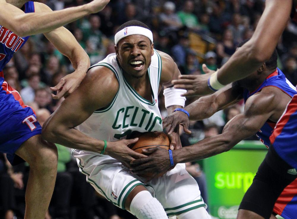 Boston Celtics' Paul Pierce, center, runs into traffic against the Detroit Pistons in the basketball game on Sunday in Boston. The Celtics won 101-90. (AP)