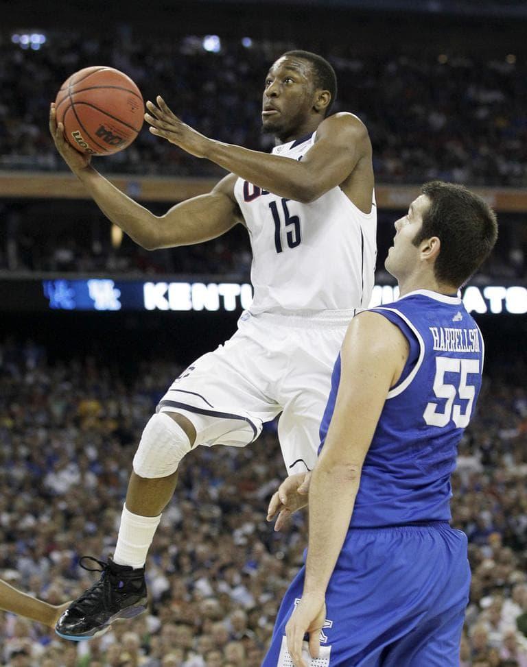 Connecticut's Kemba Walker shoots over Kentucky's Josh Harrellson during their Final Four game Saturday. (AP)