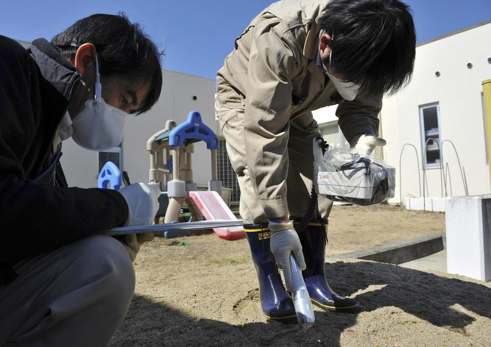 Government employees monitor radiation levels at a daycare center in Iitate, Fukushima prefecture, northern Japan Tuesday. (AP)
