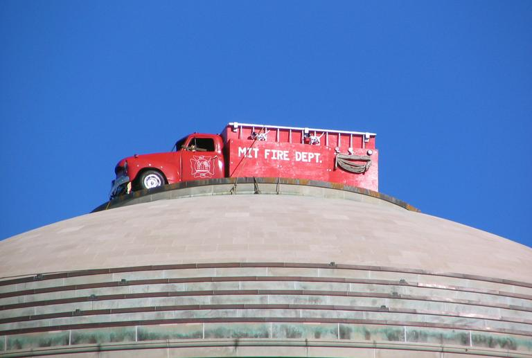A famous MIT hack that saw a fire truck perched on the roof of the MIT dome. (François @ Edito.qc.ca/Flickr)