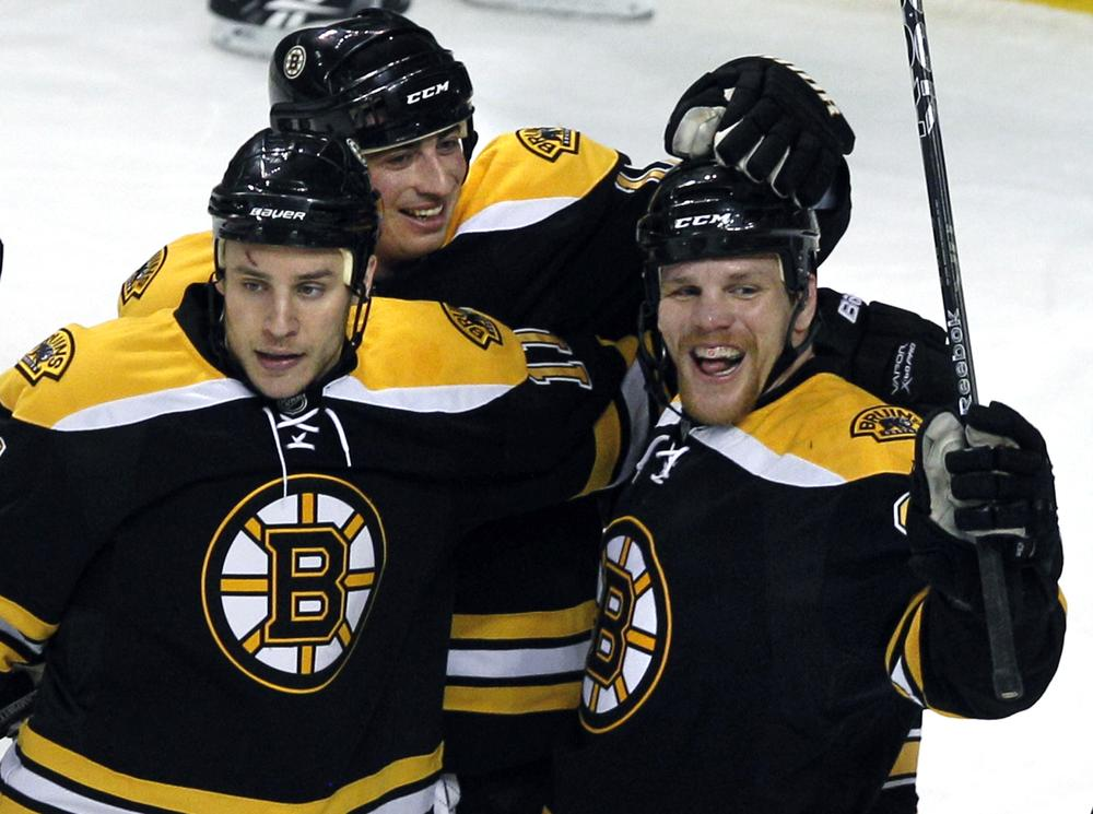 Boston Bruins right wing Shawn Thornton, right, celebrates his goal with teammates Gregory Campbell, left, and Tomas Kaberle, of the Czech Republic, during the first period of the game against the New York Islanders in Boston on Wednesday. (AP)