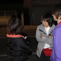 People react in the street after a strong aftershock in Ishinomaki, Iwate Prefecture, northern Japan, Friday, April 8, 2011. (AP)