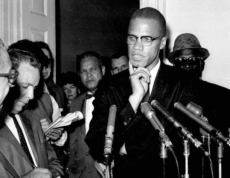 Malcolm X speaks to reporters in Washington, D.C., in 1963. (AP)