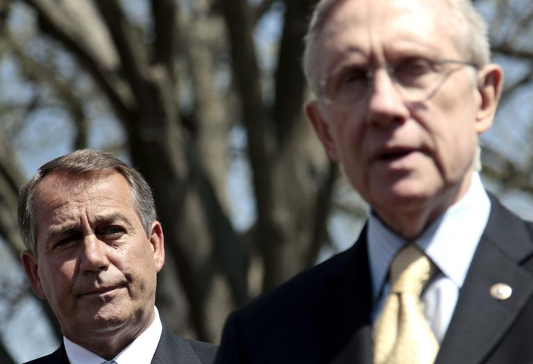 House Speaker John Boehner listens to Senate Majority Leader Harry Reid speak outside the White House in Washington, Thursday. (AP)