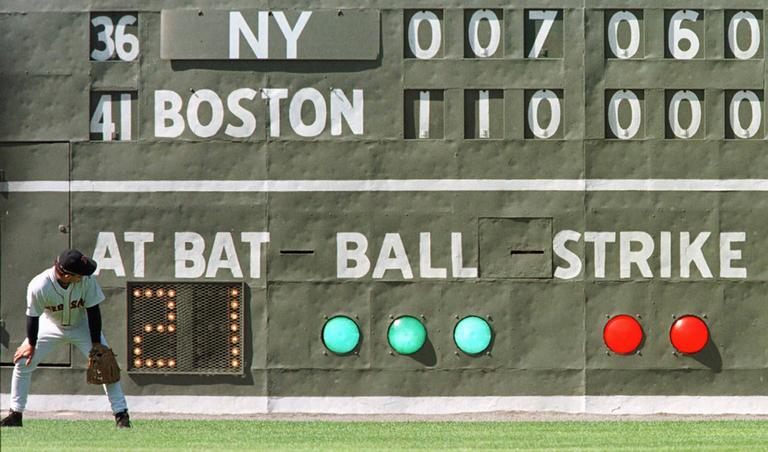 The original Green Monster scoreboard, shown here in 1998, no longer resides at Fenway Park. (AP)