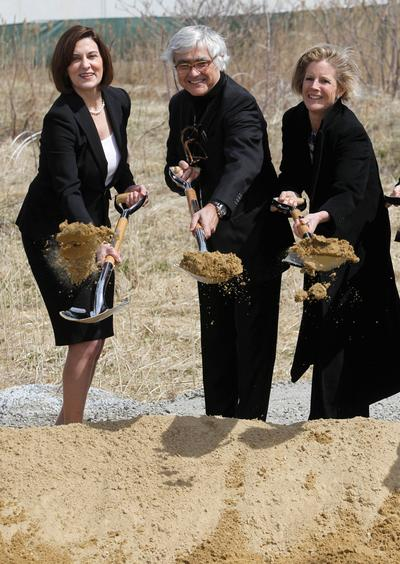 From left, Vicki Kennedy, widow of Sen. Edward M. Kennedy, architect Rafael Vinoly and Kara Kennedy, daughter of the late senator, shovel dirt during groundbreaking ceremonies for the new Edward M. Kennedy Institute for the United States Senate, in Boston. (AP)