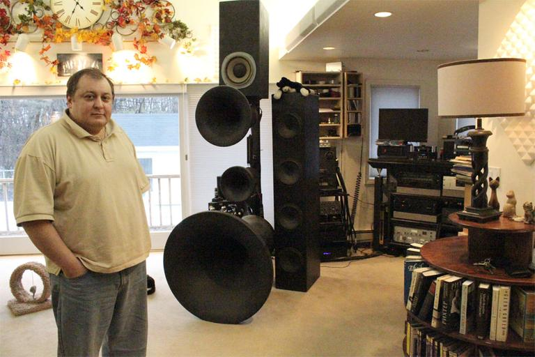 Romy Bessnow is pessimistic about the BSO's conductor search. He prefers to listen to past recordings on his massive sound system in his Woburn home. (Andrea Shea/WBUR)