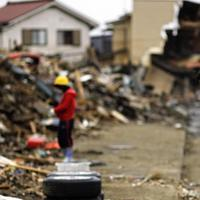 Japanese stop for a moment of silence at 2.46pm, exactly a month after a massive earthquake struck the area in the port town of Kesennuma, Miyagi Prefecture, Japan.(AP)