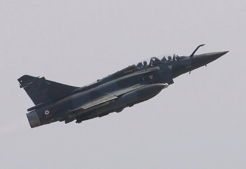 A French jet fighter takes off for a mission to Libya at Solenzara 126 Air Base, on Corsica Island. (AP)