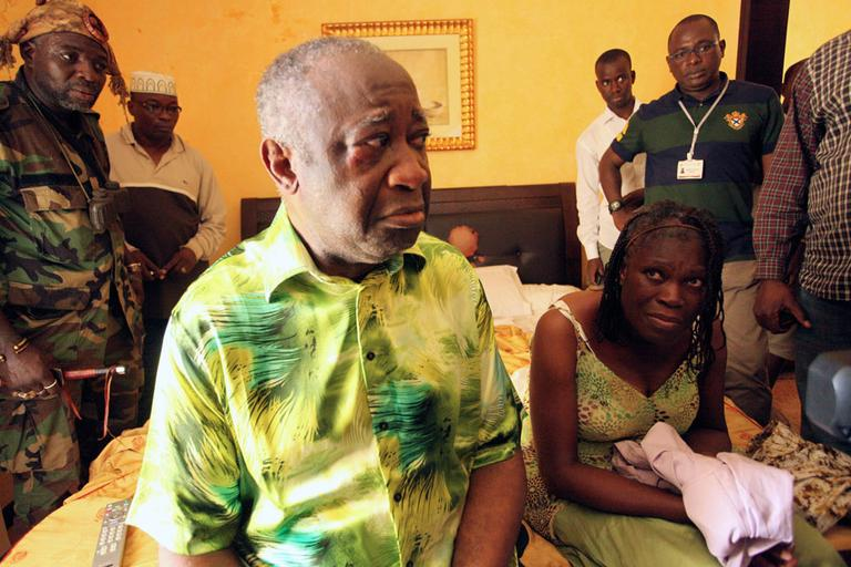 Former Ivorian President Laurent Gbagbo and his wife, Simone, are seen in the custody of forces loyal to President-elect Alassane Ouattara at the Golf Hotel in Abidjan, Ivory Coast, Monday. (AP)