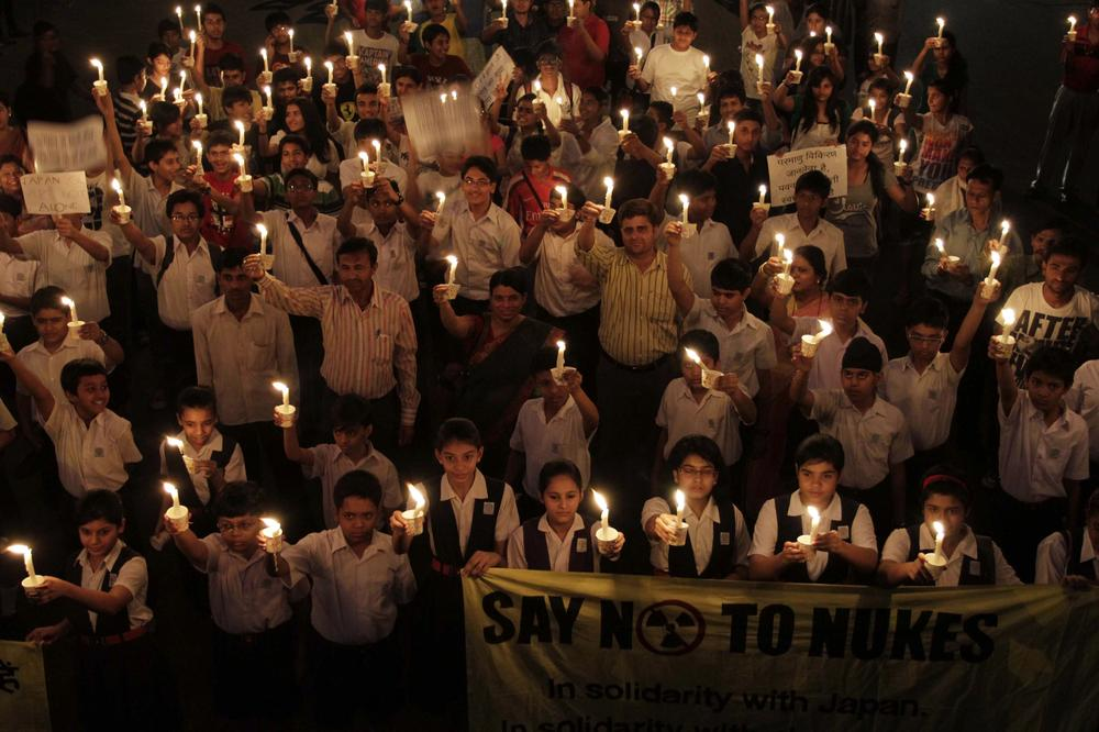 Indians participate in a candle light vigil in Ahmadabad, India, on Monday to protest the country's plans to increase its nuclear power by 600 percent.  (AP)