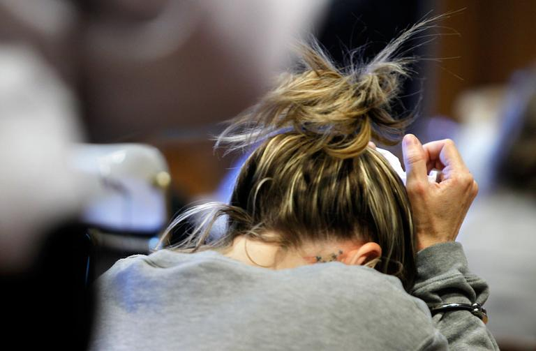 Kristen LaBrie weeps before being sentenced to eight to 10 years in prison at Lawrence Superior Court, in Lawrence on Friday. (AP)