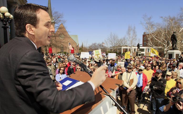 Former Minnesota Gov. Tim Pawlenty addresses the Tea Party rally in Concord, N.H., on Friday. (Fred Thys/WBUR)