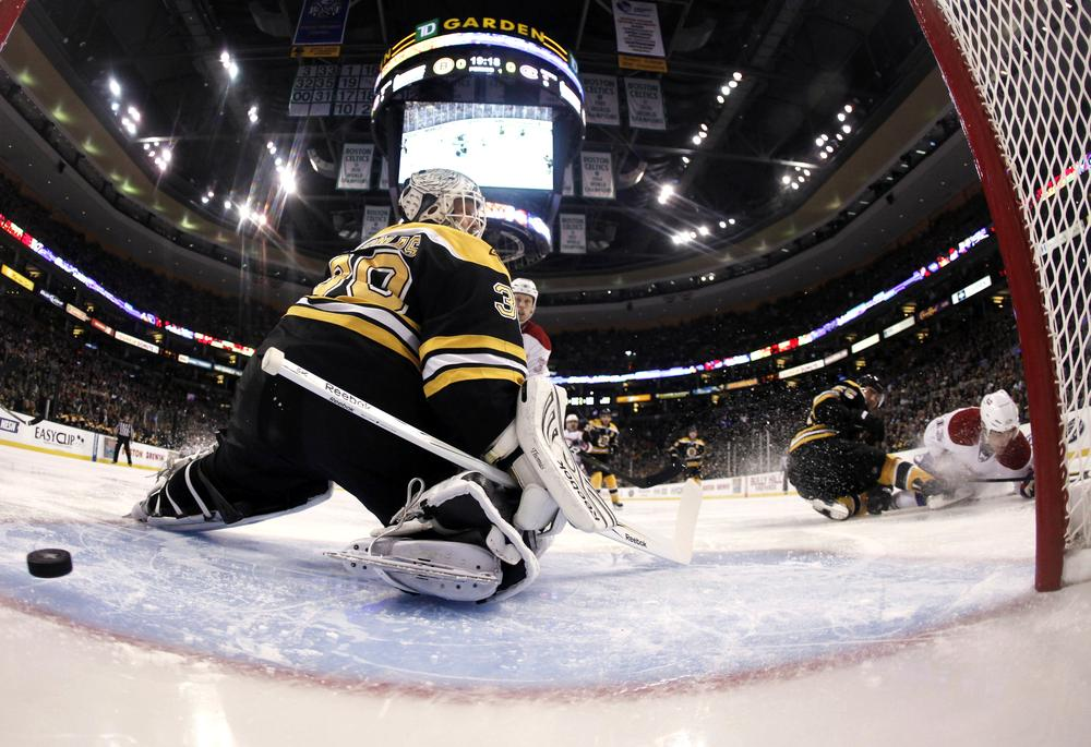 Bruins goalie Tim Thomas looks back as a shot by Montreal Canadiens' Mike Cammalleri, right, goes in for a goal during the first period of Montreal's 3-1 win in Game 2 in Boston Saturday. (AP)