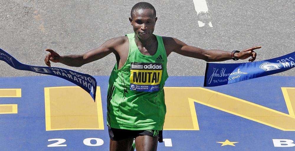 Geoffrey Mutai of Kenya breaks the tape to win the men's division at the finish line of the 115th Boston Marathon in Boston. (AP)