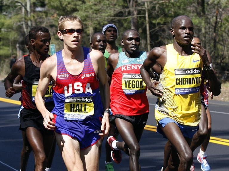 Elite male runners including Ryan Hall, of the United States, and Robert Kiprono Cheruiyot, of Kenya, run the 115th Boston Marathon in Wellesley, Mass., Monday. (AP)