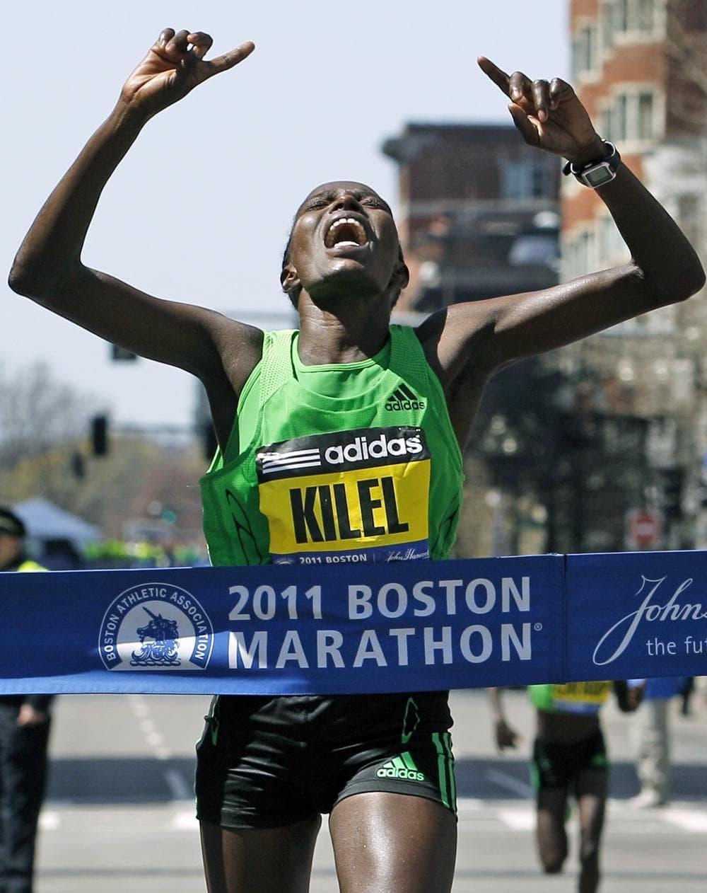 Winner Caroline Kilel of Kenya reacts as she crosses the finish line of the 115th Boston Marathon in Boston Monday. (AP)