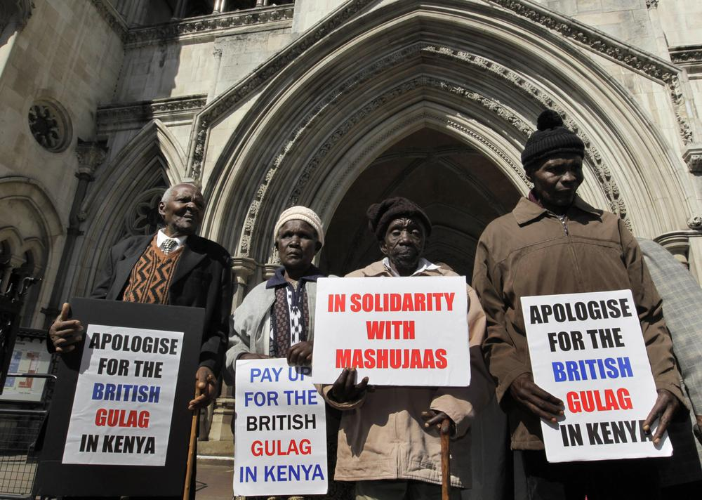 Kenyans (left to right) Wambugu Wa Nyingi,  Jane Muthoni Mara,  Paulo Nzili and Ndiku Mutua, stand outside the Royal Courts of Justice, in central London. They are taking the British government to court over alleged atrocities in the 1950s in what is now Kenya. (AP)
