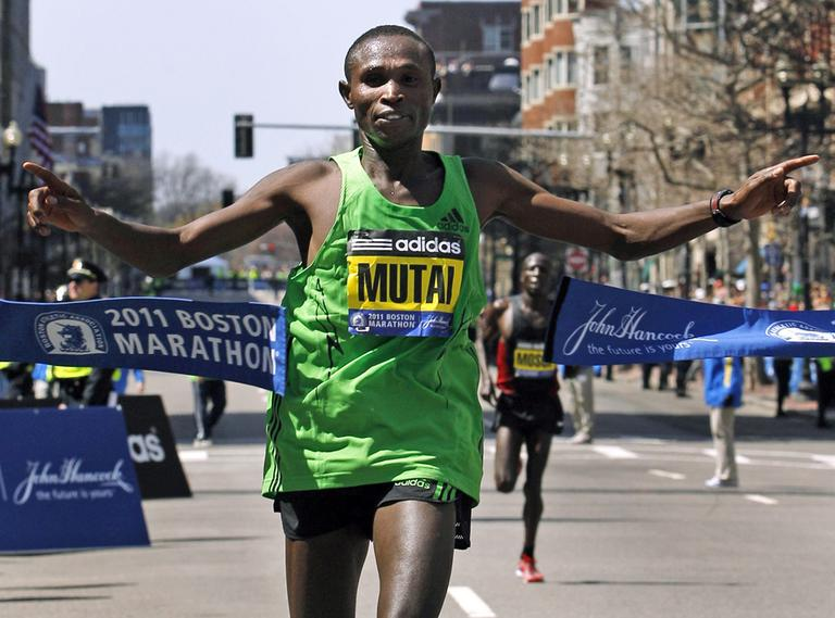 Geoffrey Mutai breaks the tape to win the men's race at the 2011 Boston Marathon. (AP)