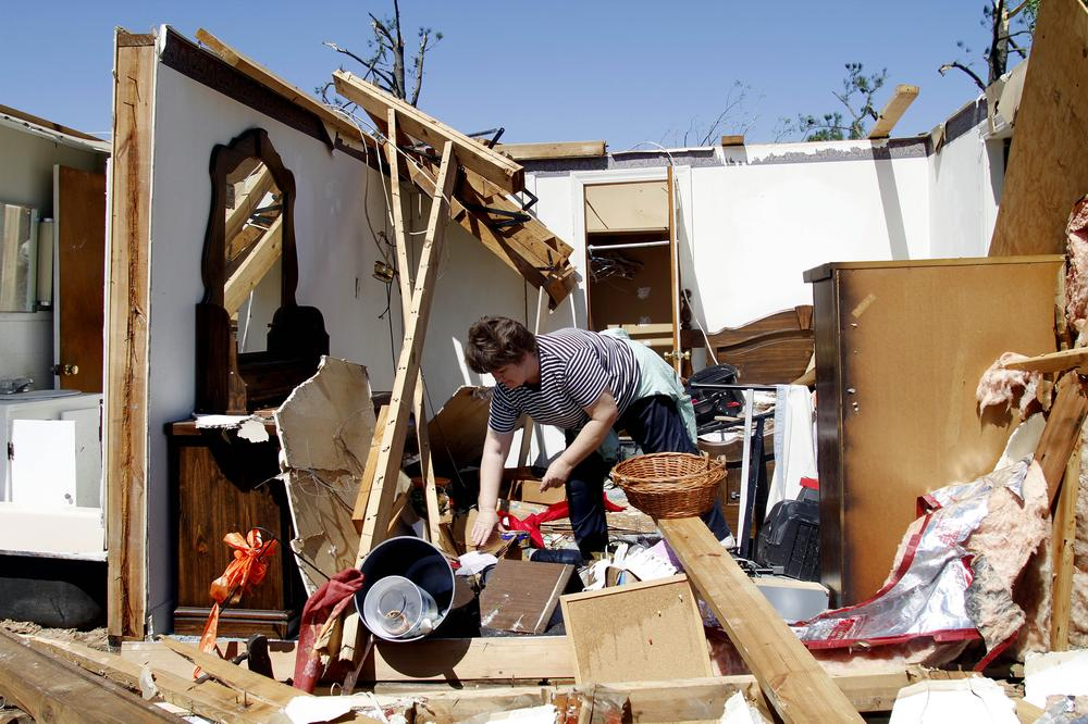 Deborah Dulow cleans up her father's house in Askewville, N.C., after a tornado moved through the area Saturday. (AP)
