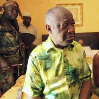 Former Ivorian President Laurent Gbagbo, center, and his wife Simone, are seen in the custody of republican forces loyal to election winner Alassane Ouattara at the Golf Hotel in Abidjan, Ivory Coast, Monday, April 11, 2011. (AP)