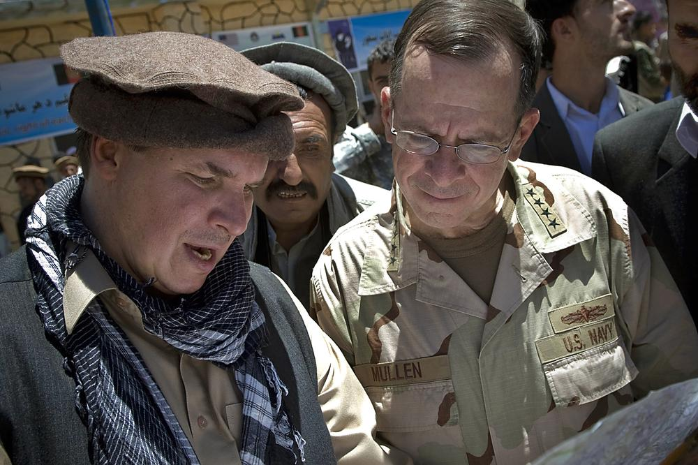 In this July 15, 2009 photo, author Greg Mortenson shows the locations of future village schools to U.S. Navy Adm. Mike Mullen. (AP/Department of Defense)