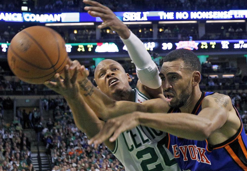 Boston Celtics guard Ray Allen reaches for the ball next to New York Knicks forward Jared Jeffries during the first half of Game 2 of the playoff series in Boston on Tuesday. (AP)