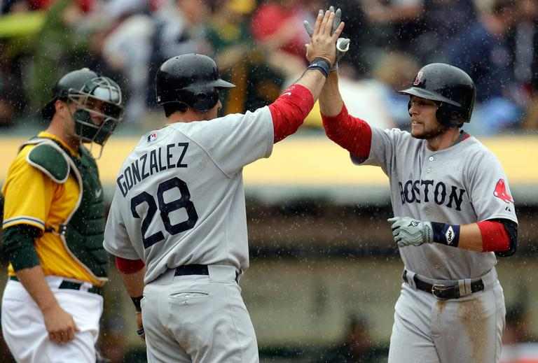 Boston Red Sox shortstop Jed Lowrie, right, is congratulated by Adrian Gonzalez following his home run against the Oakland Athletics on Wednesday afternoon. (AP)