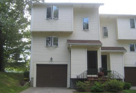 This listing photo shows a townhouse at 35 Diamond St., which is attached to the 31 Diamond St. townhouse in Walpole.