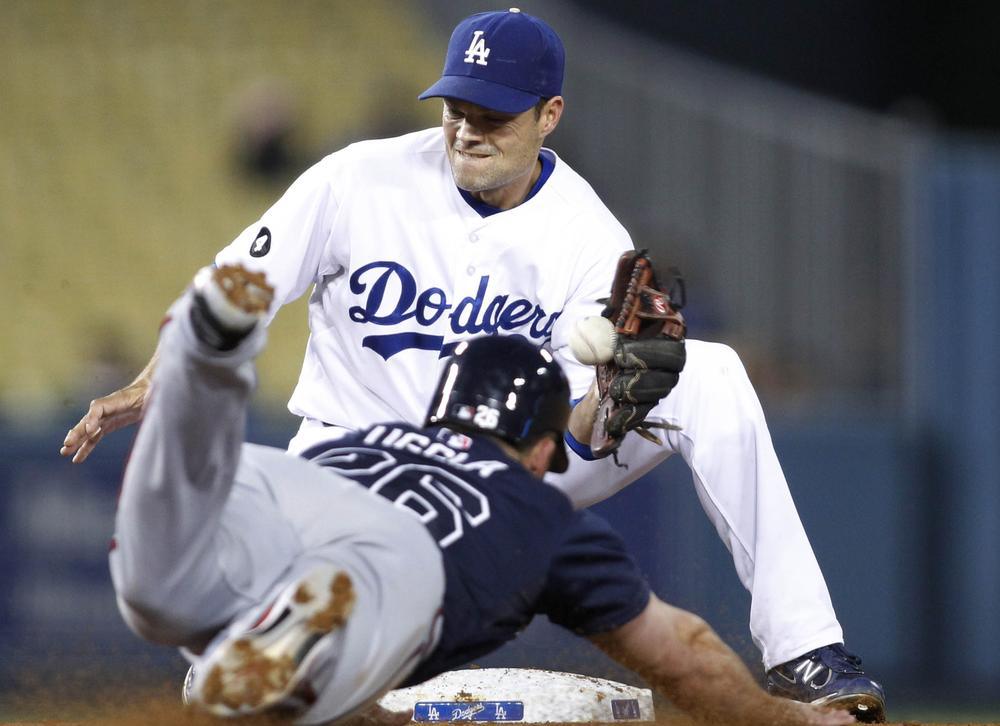 On the field, it's business as usual for the Los Angeles Dodgers, but in the front office major changes are underway. (AP)