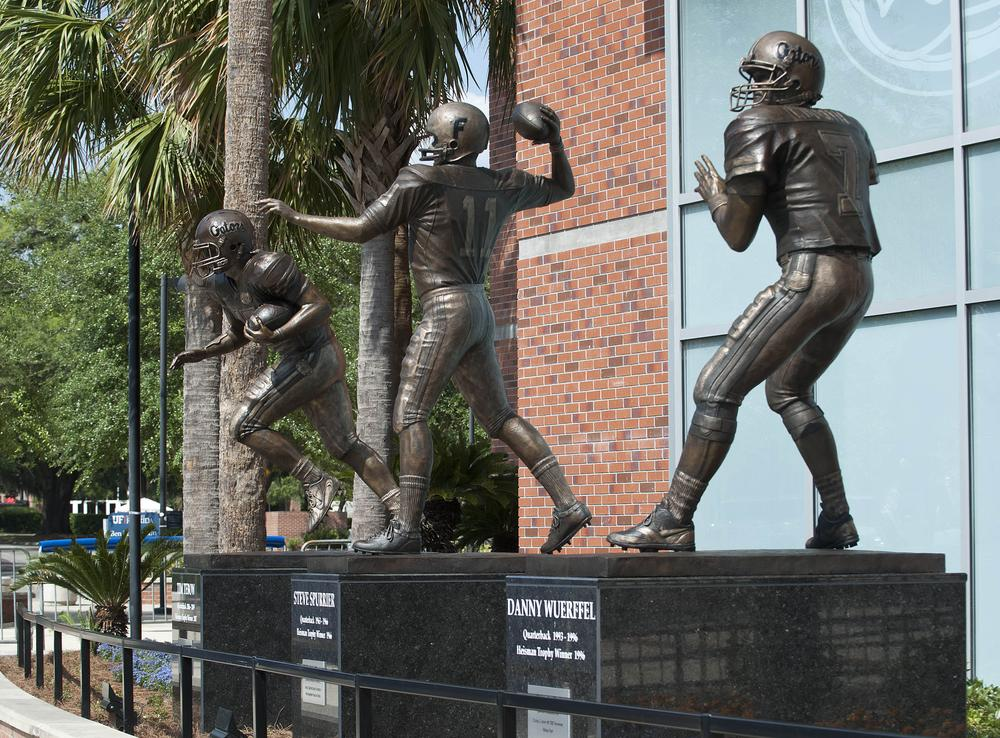 The statues of former Florida  Heisman Trophy winners, from left, Tim Tebow, Steve Spurrier and Danny Wuerffel are displayed outside of Ben Hill Griffin Stadium. (AP)