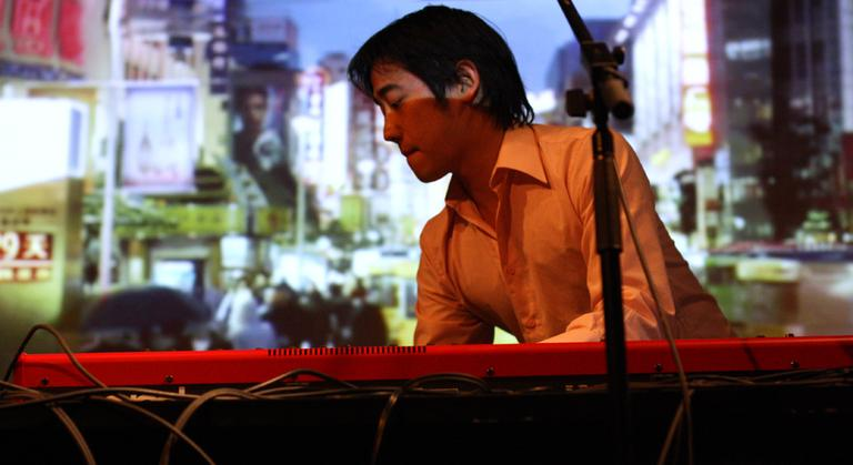 Dave Liang plays the keyboard in The Shanghai Restoration Project (Anna Hiort/Courtesy)