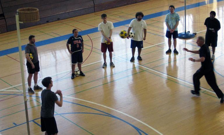Barker teaches students how to pass the korfball (Doug Tribou)