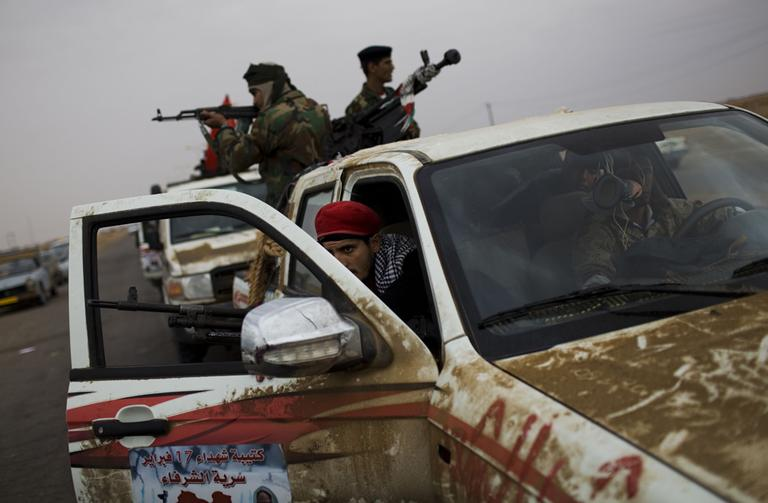 Libyan rebel fighters prepare to engage pro-government forces in the outskirts of Ajdabiya, Libya. (AP)