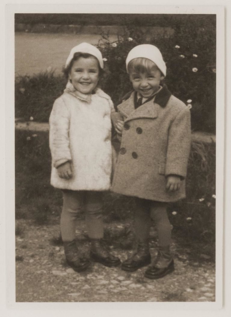 Renata Guttman, left, with her twin brother, Rene, before the war. (Courtesy Irene Hizme)
