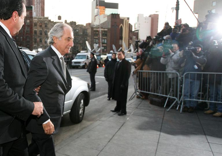 Bernie Madoff enters federal court to plead guilty to fraud charges in New York, March 12, 2009. (AP)
