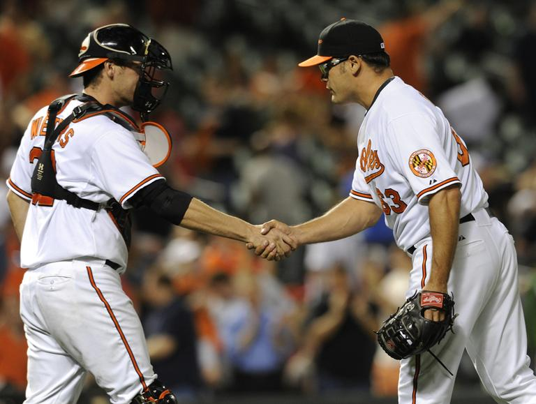 Baltimore Orioles pitcher Kevin Gregg and catcher Matt Wieters celebrate after defeating the Boston Red Sox 4-1 Tuesday. (AP)