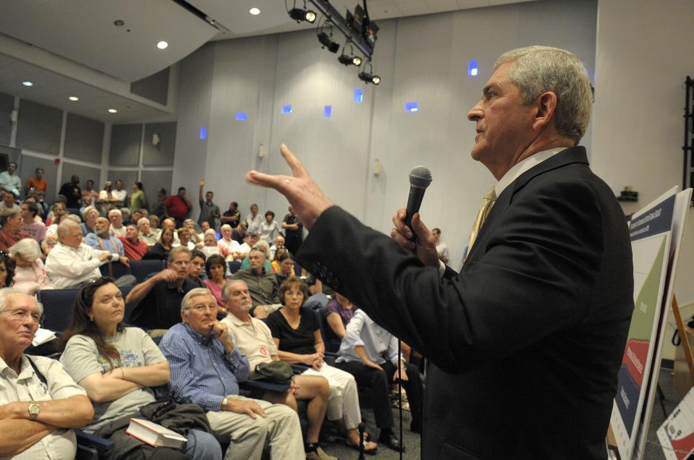 Rep. Daniel Webster, R-Fla., right, answers questions from constituents during a crowded town hall meeting in Orlando, Fla. (AP)