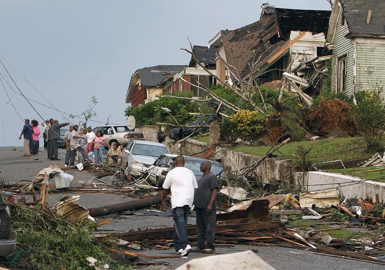 Residents survey the destruction after a tornado hit Pratt City, Ala. just north of downtown Birmingham, Ala., on Wednesday. (AP)
