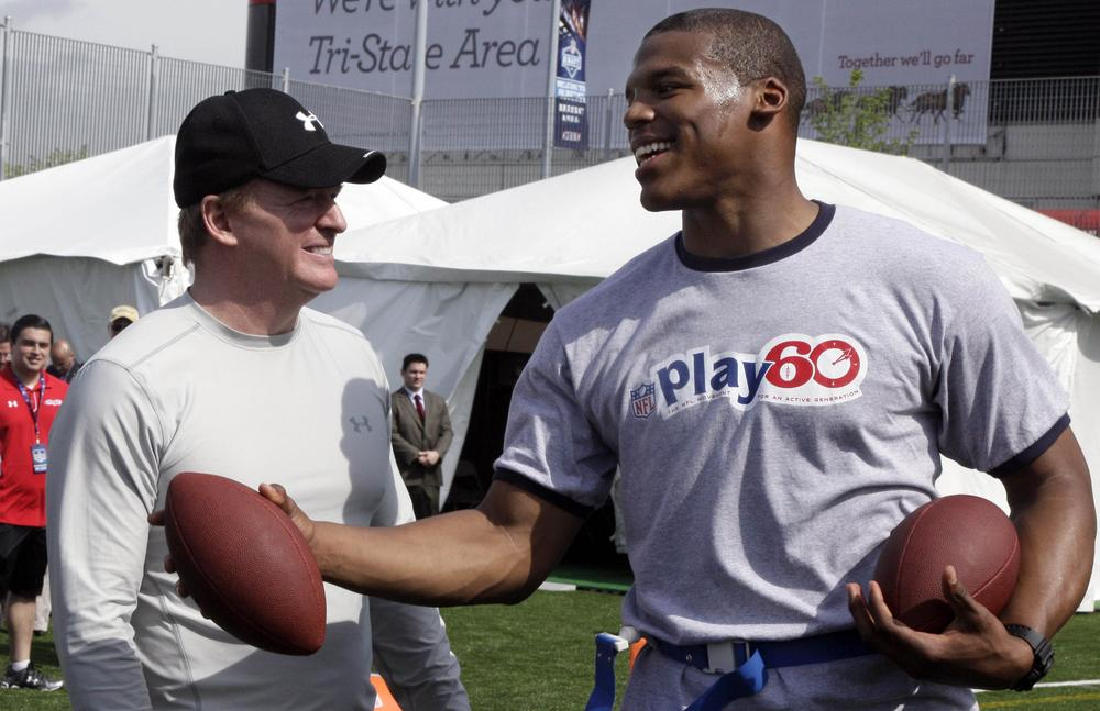 Despite the smiles on the faces of NFL Commissioner Roger Goodell (l) and the top pick of 2011, Cam Newton, the league's labor issues are far from being resolved. (AP)