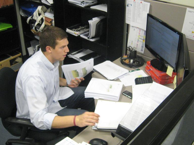 Pats punter Mesko, at his private equity desk (Curt Nickisch/WBUR)