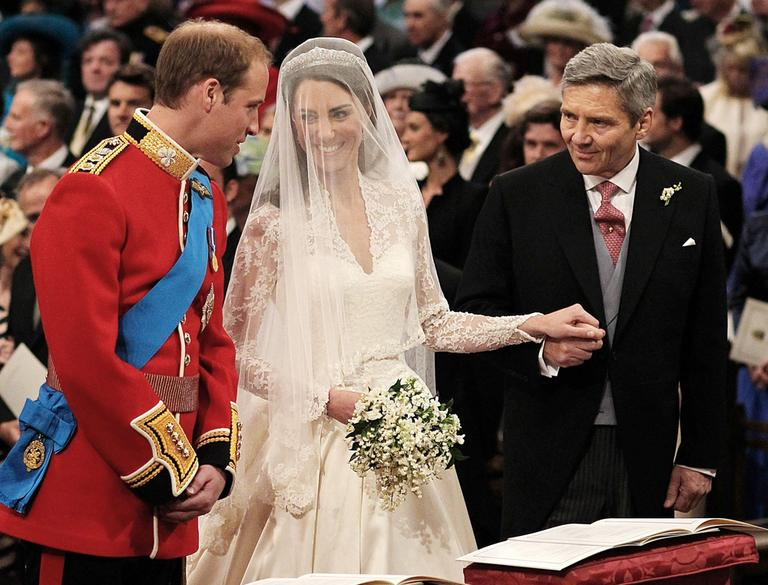 Prince William greets Kate Middleton as she arrives at the alter with her father prior to their marriage. (AP)