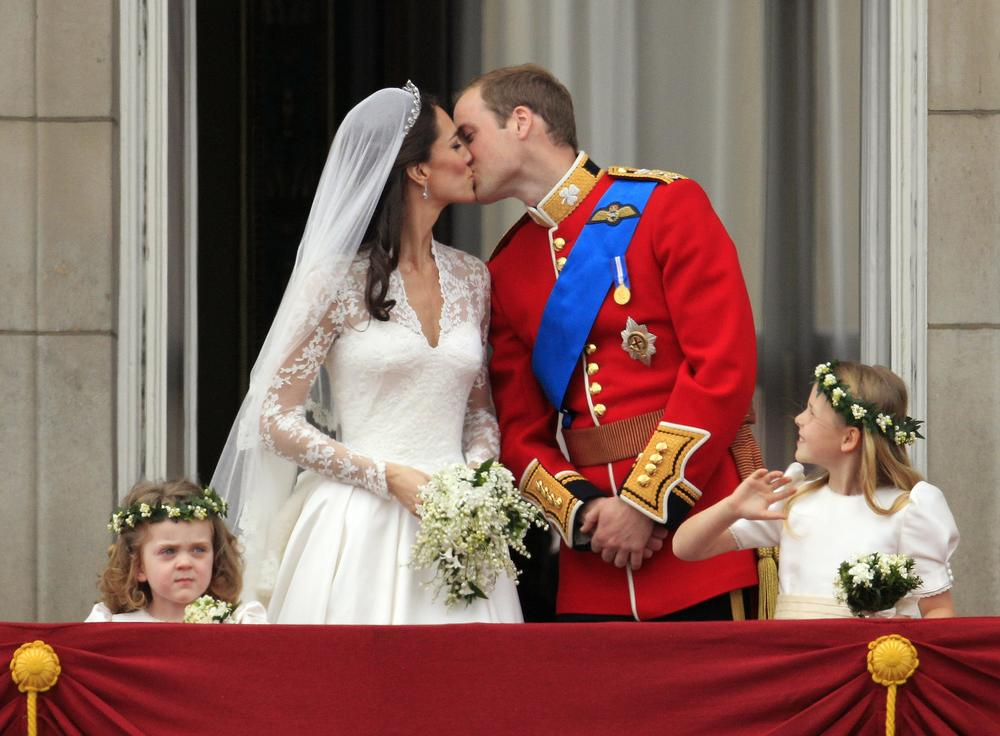 Britain's Prince William kisses his wife Kate, Duchess of Cambridge, on the balcony of Buckingham Palace after the Royal Wedding in London Friday. (AP)