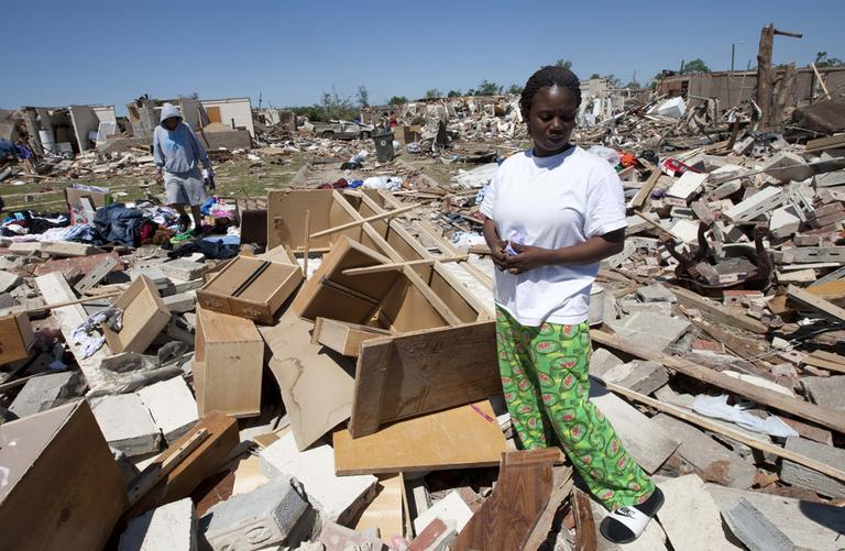 Robbie Thomas cries as she looks through her tornado ravaged home in Tuscaloosa, Ala., Friday. (AP)