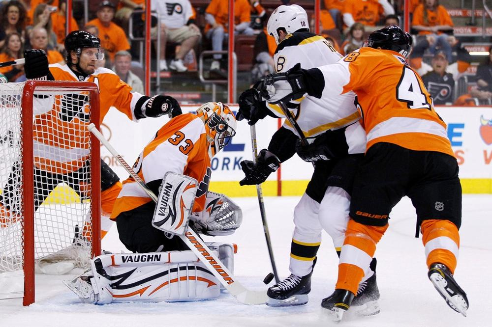 The Bruins' Nathan Horton scores a goal against Philadelphia Flyers' Brian Boucher during Game 1 of the Eastern Conference semifinal in Philadelphia. (AP)