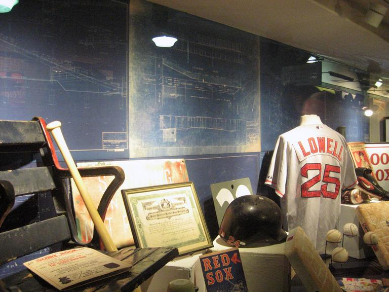 A new display under the Fenway Park grandstand features Sox artifacts, including blueprints for the 1934 Green Monster expansion. (Curt Nickisch/WBUR)