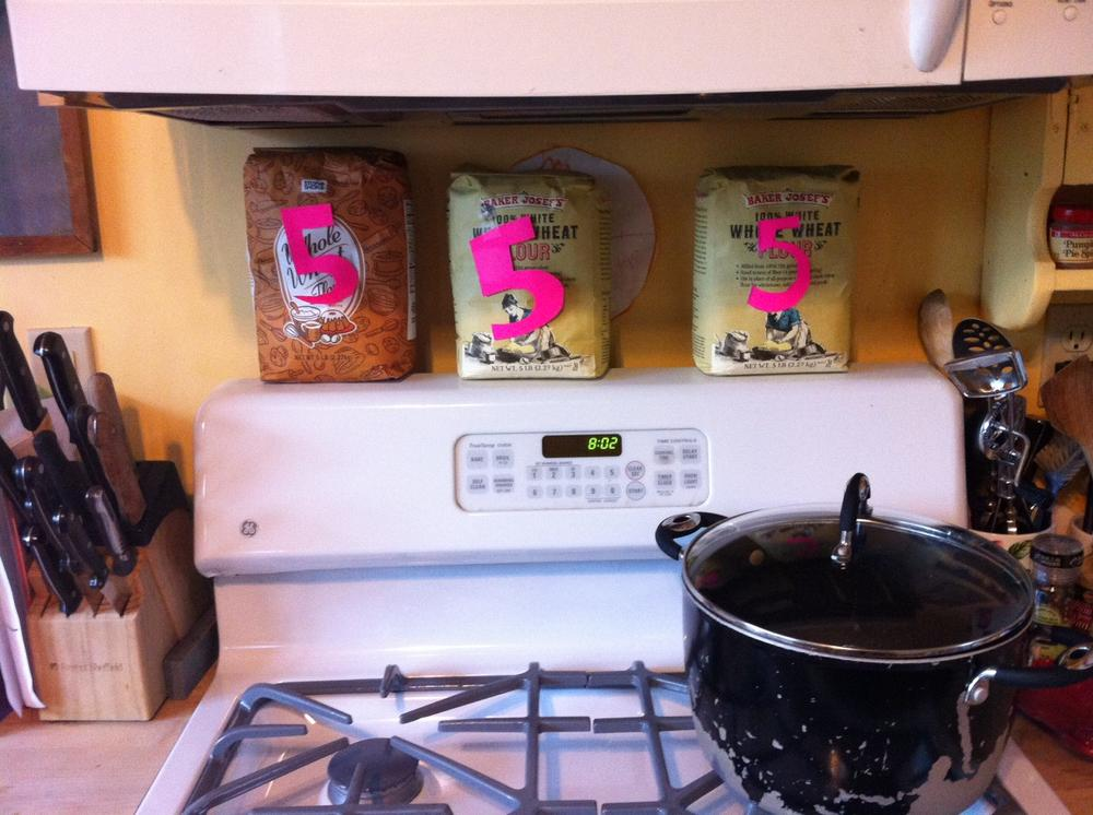 Flour bags representing the 15 pounds I lost — and regained