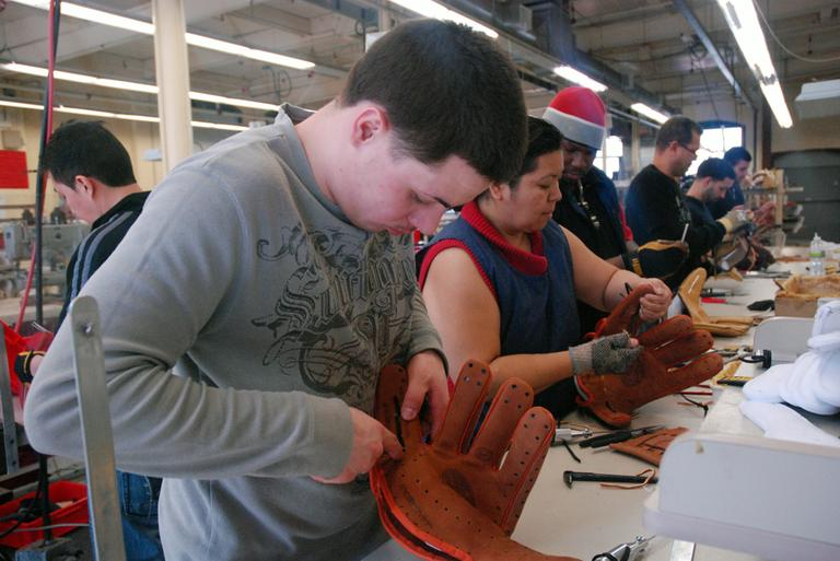 An Insignia worker builds a glove from scratch. (Jesse Costa/WBUR)